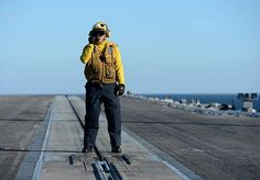 (Jan. 10, 2013) Aviation Boatswain's Mate (Handling) 2nd Class Justin Shumaker communicates with flight deck control during flight operations aboard the aircraft carrier USS George H.W. Bush (CVN 77).