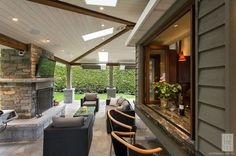 Kitchen pass-thru to outdoor living area | Contemporary Patio by Synthesis Design Inc.