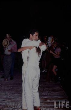 1203-Carolyn Bessette Kennedy and John Kennedy Jr summer dancing in the Hamptons.