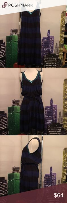 French Connection striped sequined dress. Size 2 This dress is absolutely fabulous and in perfect condition 👌 👌👌  I wore it once for a news years party and it's been in my closet ever since... 😔   This dress is has blueish/purplish and black stripes. The sequined is an aqua color. Can be worn with a belt or not. There is a little thread in the dress that allows you to hang the belt so you never loose it!   This dress can be worn with leggings, jeans or tights. So versatile and ready for…