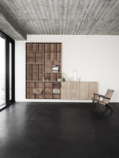 Wood Plank Textured Concrete Ceiling and Embedded Wood Wall Bookcase