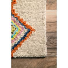 This hand-tufted wool area rug features a striking moroccan pattern. This soft and plush area rug was meticulously handcrafted to create a luxurious boldness and softness underfoot. Pile Height: 0.51