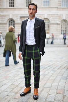 05-07-15; i love this exaggerated plaid on these trousers! This makes me think of applying different proportions than the norm to conventional garments. (And look at the leather spats)