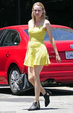 Diane Kruger, yellow summer dress and black accessories.