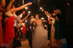 """sparklers arch"" to welcome the bride and groom to the reception!"