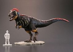 Kaiyodo feather Dinosaur ... One great model with a human figure for reference