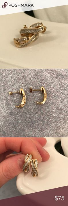 10kt yellow gold diamond earrings 10kt yellow gold diamond earrings. There is a diamond missing on one of the earrings at the top as pictured! I'm sure a jeweler could replace it for a small fee. Jewelry Earrings