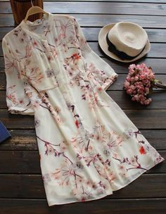 Awesome one to show off this fall! It is a chiffon shirt dress detailed with peach blossom print&half sleeve. What is more, it does button all the way! Enjoy this dreamlike feeling with Cupshe.com .