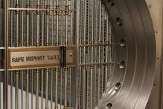 Photo about A bank s large safe deposit box vault gated shut. Image of cell, institution, bank - 15259450