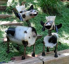 Whimsical bovines add a fun touch anywhere in the landscape. Both adult and calf make for unusual garden accents with bobble heads and huge grins, ideal for greeting guests on front walk or porch, per