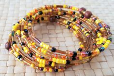 Hand - made spiral bracelet made from brown, black, orange and yellow pearls of glass by Ebooksandhandmade on Etsy Yellow Pearl, Bracelet Making, Spiral, Beaded Bracelets, Pearls, Orange, Brown, Glass, Handmade