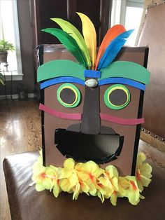Tiki/Hawaiian style Valentine box for Kael's 2nd grade class party.  Made with double stick tape and pieces of craft foam, feathers and a $1 lei :). Aloha!!!