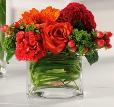Sweet thoughts is a smaller cube vase filled with a delicate bright mix of Gerbera.
