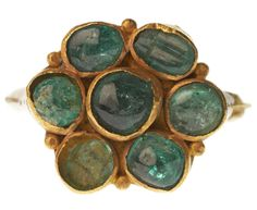 Cabochon emerald ring. From Cheapside Hoard, considered the world's largest and finest collection of jewelry from Britain's Elizabethan and early Stuart periods.