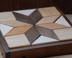 Our puzzles are made with maple or poplar, cherry, walnut and oak pieces. The large puzzle has 32 pieces and can be arranged in hundreds of symetrical and asymetrical patterns. The oak squares are 2 X 2 X 7/8. Pictured are four symetrical patterns. The box is 10 3/4 square. Shipping: I ship almost all of my pieces via USPS Priority Mail, insured, signature required. The signature is required for insurance. Most items in the lower 48 arrive in 2-3 days. If you are not concerned abo...