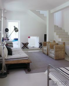 The foyer of de la Fressange's home in Tarascon, France; the straw armchairs are from Caravane.  (from Elle Decor)