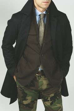 layers with brown/Autumn color accents; camo pants, espresso coat, tan tweed tie