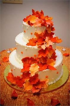 Orange Fall themed three tier wedding cake with leaves