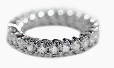 Fede a filo in oro bianco 18Kt. Diamanti carati totali 5,55.