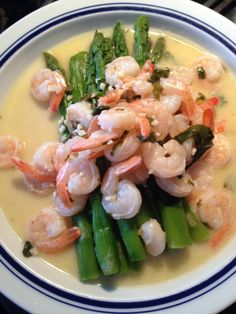 Shrimp and asparagus in a garlic lemon butter sauce with basil and fresh cracked black pepper.