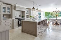 Painted in our timeless Willow and Tansy, this warm grey kitchen is as functiona… Open Plan Kitchen Dining Living, Open Plan Kitchen Diner, Living Room Kitchen, New Kitchen, Kitchen Grey, Kitchen Pantry, Awesome Kitchen, Kitchen Cupboards, Cabinets