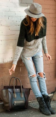 Young look for the fall: basic pieces; ripped denim, boots sweater, and hat with a tote