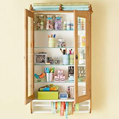 A hanging cupboard provides plenty of storage for small craft items. More ways to store your small craft supplies:  http://www.bhg.com/decorating/storage/craft-room/store-small-craft-supplies/?socsrc=bhgpin080413cupboard=1