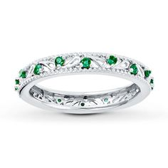 Love these emeralds. Stackable ring, so could easily add birthstone rings of my hubby and our kids someday :)