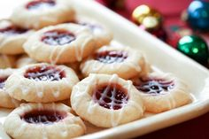 Raspberry Almond Shortbread Thumbprint Cookies - a tender shortbread cookie packed with raspberry jam and topped with a simple almond icing