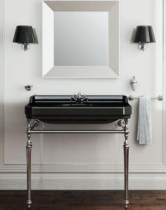 zwarte wastafel met metalen onderstel