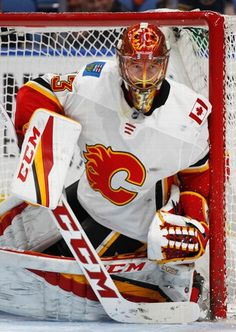 Calgary Flames goalie David Rittich (33) hugs the post during the third period of an NHL hockey game against the Buffalo Sabres, Wednesday, March. 7, 2018, in Buffalo, N.Y. (AP Photo/Jeffrey T. Barnes)