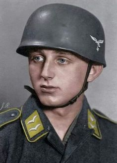 "LUFTWAFFE - A German paratrooper wearing the special ""Fallschirmjäger"" Helmet."
