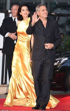 The power couple: George Clooney and his wife Amal were pictured arriving at the Tomorrowland premiere in Tokyo