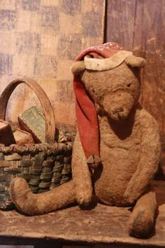 Prim Tattered Teddy...with a grungy stocking hat.