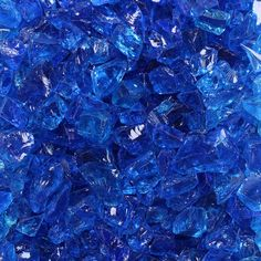 If a chunky look is what you're going for, crushed fire glass answers the call. Ready for a fire pit makeover, Replace your lava rocks or old fire glass with crushed fire glass. The eclectic sizes (ranging Blue Aesthetic Dark, Crystal Aesthetic, Marvel Wall Art, Fire Pit Accessories, Glass Fire Pit, Blue Magic, Crushed Glass, Blue Pictures, Love Blue