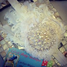 All White Feather Pad Fascinator Over The Top Headband. $18.00, via Etsy.
