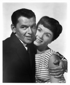 Frank Sinatra holding Debbie Reynolds in publicity portrait for the film 'The Tender Trap' 1955