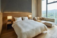 Wood-lined bedrooms, a minimal diner and a shop all feature inside the Muji Hotel in Shenzhen, which is due to open to the public later this month.