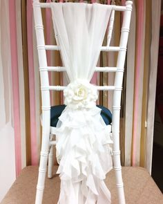Chiffon ruffle chair hood tied vertically by Ellis Events - creative chair cover hire and venue decorations. Wedding ideas. Chair sash ideas. Chair cover ideas. Ribbon backdrop. Sequin Linen.