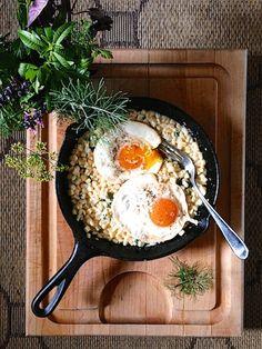 Creamed corn 'n eggs with fresh herbs at feedmedearly.com | Sautéed corn kernels, butter, heavy cream, chopped herbs | Vegetarian, CSA, recipe