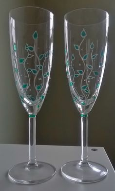 Hand painted champagne flutes, using a translucent colored paint.