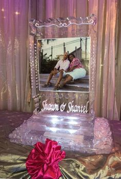 Engagement picture frozen into an ice sculpture for a reception.  #icesculpture  #weddingice