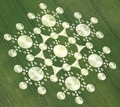 A 780 ft (240 m) crop circle in the form of a double (six-sided) triskelion composed of 409 circles. Milk Hill, England, 2001.