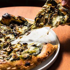 Roast mushrooms get topped with gooey raclette cheese and surrounded by a garlic-butter crust in this killer pizza from 21 Greenpoint.