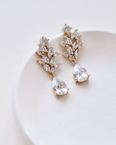 ANNA FLORAL CZ EARRINGS Effortlessly elegant, bridal earrings Anna are perfect for the bride looking for understated sparkle. Designed with round & marquise shaped CZs that descend into a pear shaped drop. Gold Bridal Earrings, Rose Gold Earrings, Rhinestone Earrings, Bridesmaid Earrings, Wedding Earrings, Wedding Jewelry, Fine Jewelry, Women Jewelry, Silver Jewellery
