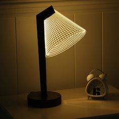 A lamp where the *shade* is actually the *light* (a 3D LED one, to be specific). | 37 Awesome Things You Never Knew You Needed For Your Home