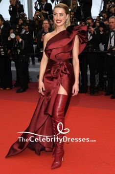#AmberHeard looked gorgeous in a wine-red high slit one-shoulder formal #gown with a belt at the #2019Cannes Film Festival screening of 'Pain and Glory.'