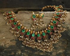 Latest Indian Gold and Diamond Jewellery Designs: Classic emerald ruby gold necklace with pearls