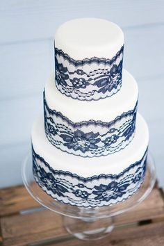 3-layer wedding cake with navy blue floral lace, great for summer weddings.