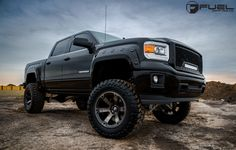Most trucks are designed for work, and the 2015 GMC Sierra is no different. The thing that separates the GMC from the rest of the pack is its higher-end touch. There's more chrome, comfortable trimmings, and high-tech goodies inside and out that make it a work truck for the head of the job site. This 2015 #GMC Sierra takes that to the next level thanks to a big-time lift kit and a set of new Fuel Wheels. #LOVE http://www.wheelhero.com/rims-and-tires
